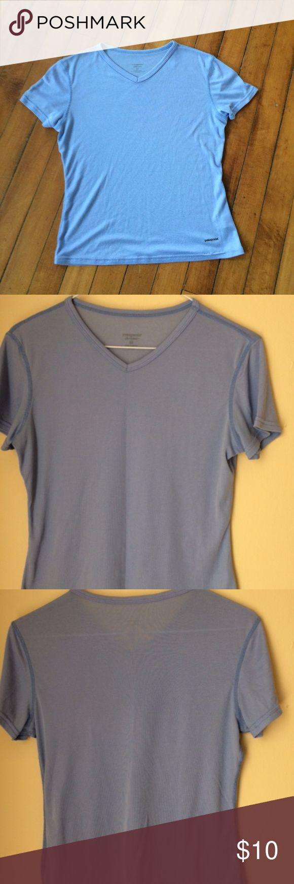 Patagonia Women's S Capilene T-Shirt Base Layer Patagonia women's blue short sleeve base layer. V-neck style. Some very small marks. Overall in great used condition. Also the truer color is the one that is NOT the cover photo. Patagonia Tops Tees - Short Sleeve