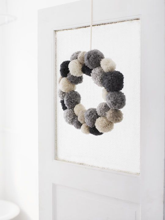 It is a lot of work to make all the pompoms but it is well worth it. I love my fluffy furry wreath.: