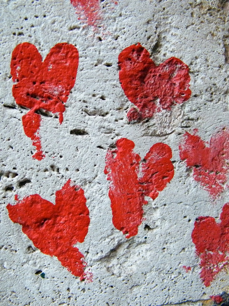 #red #hearts on a white #wall