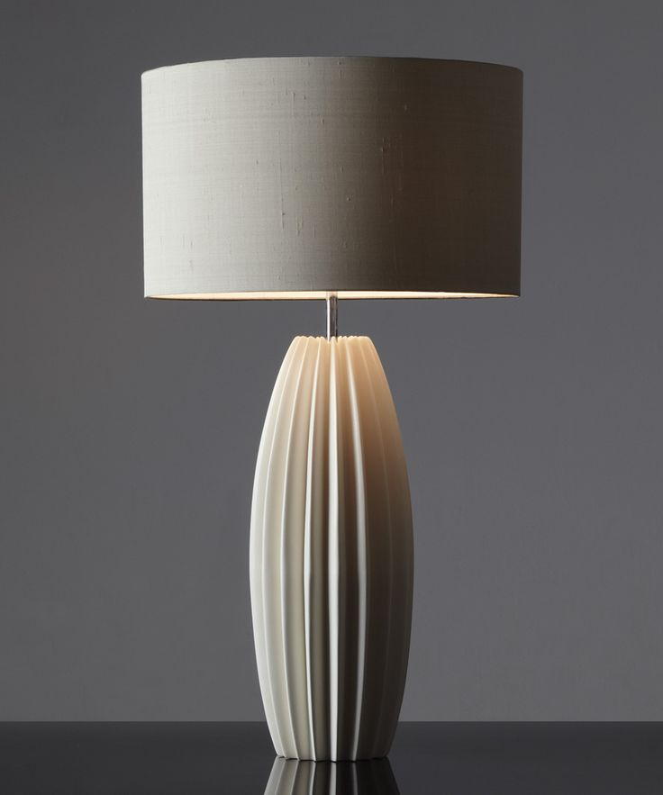 Galileo is a large ceramic table lamp available in two different sizes