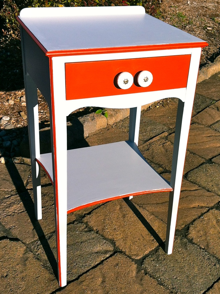 Hand-painted single drawer side table with red accents and porcelain drawer pulls