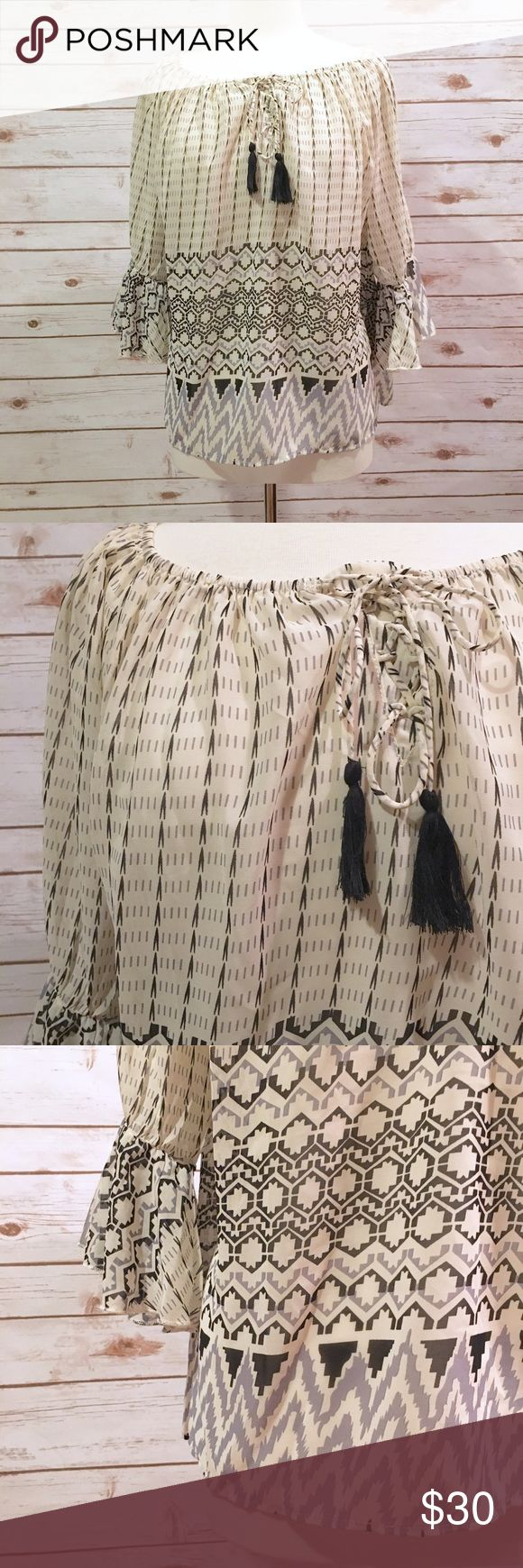 """NWT Umgee Ivory Printed Bohemian Blouse Chic bohemian blouse by Umgee. ▪️25"""" long ▪️26"""" pit to pit ▪️16"""" arm length ▪️NWT from boutique ▪️In great condition   🚭 Smoke-free home 📬 Ships by next day 💲 Price negotiable  🔁 Open to trades  💟Happy Poshing!💟 Umgee Tops"""