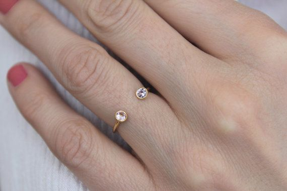 Double gemstone ring designed in a horseshoe shape.  Material: 18k solid gold, 2x 0,06 (3mm) carat PINK SAPPHIRE excellent cut Ring is 1.5mm thick. I