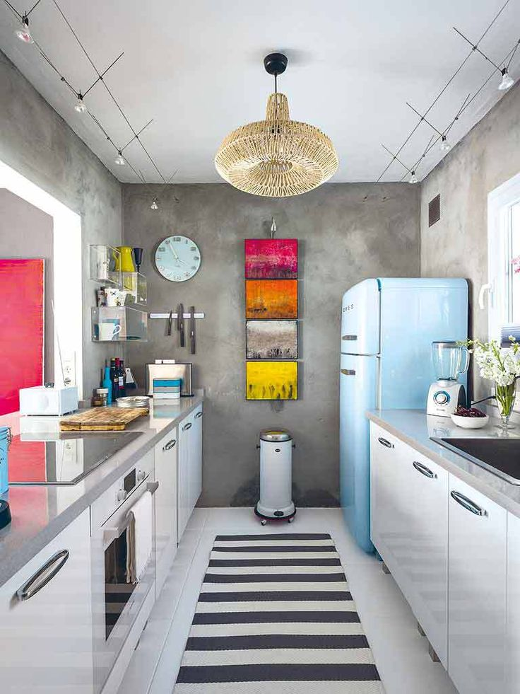 Cute Small Kitchen, I dig it! I'd change that chandilier out tho, I'm not about that life. Love the white cabinets and silver countertop.