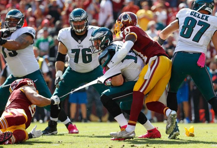 Eagles vs. Redskins:     October 16, 2016   -  27-20, Redskins  -    Philadelphia Eagles quarterback Carson Wentz's jersey tears as he is tackled by Washington Redskins outside linebacker Ryan Kerrigan, left, and free safety Will Blackmon in the first half of an NFL football game, Sunday, Oct. 16, 2016, in Landover, Md.
