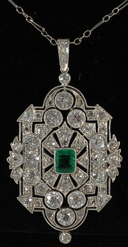 An Art Deco pendant set in platinum with emeralds and diamonds. #ArtDeco #pendant