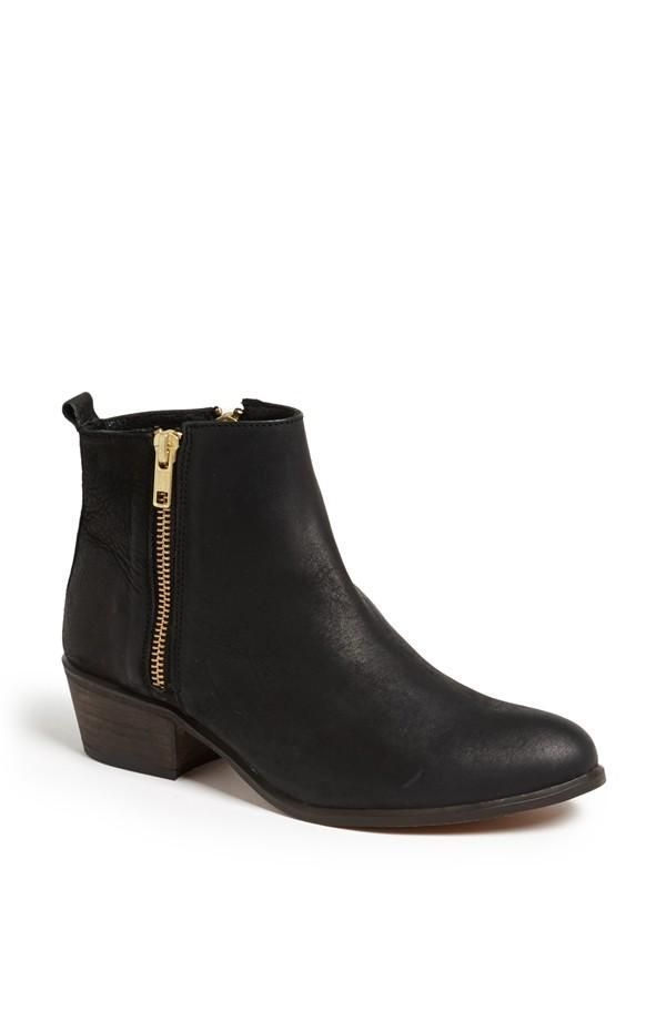 Black booties with gold side zippers