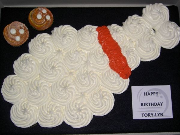 pin made out of grouped cupcakes. with bowling ball cake for F?