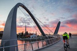 TWA-0048734 © WestPix A cyclist and a walker were not deterred by the cold morning at Elizabeth Quay this morning. Pic Mogens Johansen, The West Australian