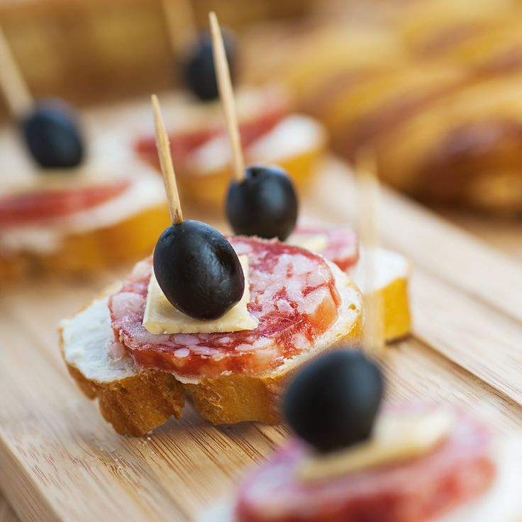 Sausage sandwiches, cheese and olives