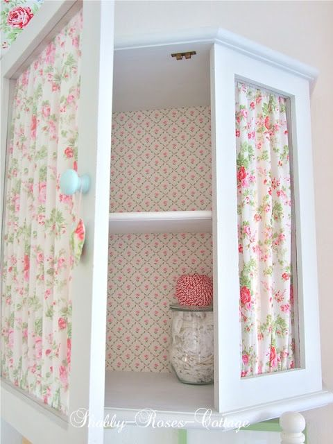 "I always loved the look of ""curtains"" behind a glass cabinet door. It gives off such a shabby chic cottage look."