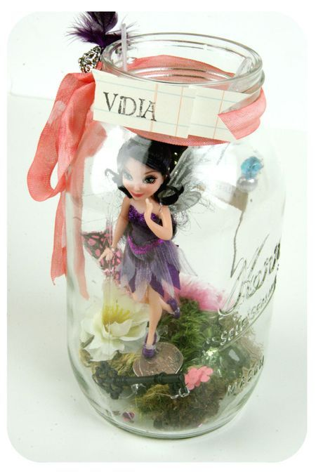 Fairy jars. Not wild about the name tag or the actual fairy in the jar, but those things can be easily changed! Cute idea!