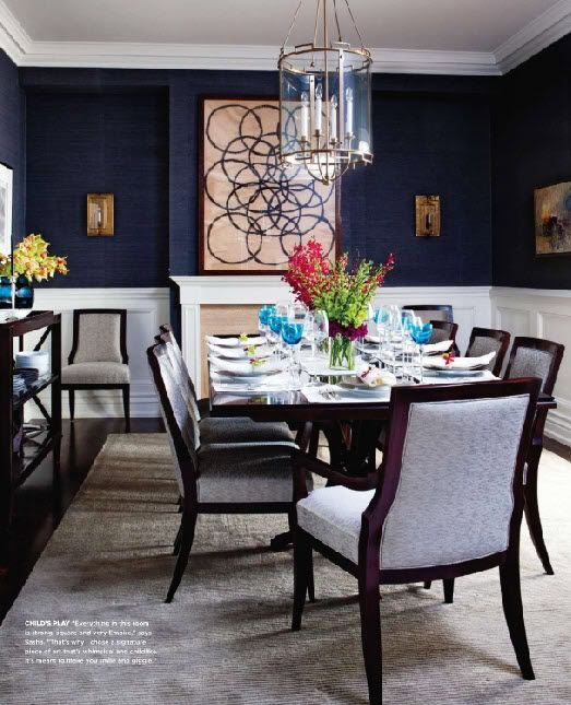 navy grasscloth on the walls with crisp white trims, brass light fittings, stunning dark wood floors and a silk carpet underfoot