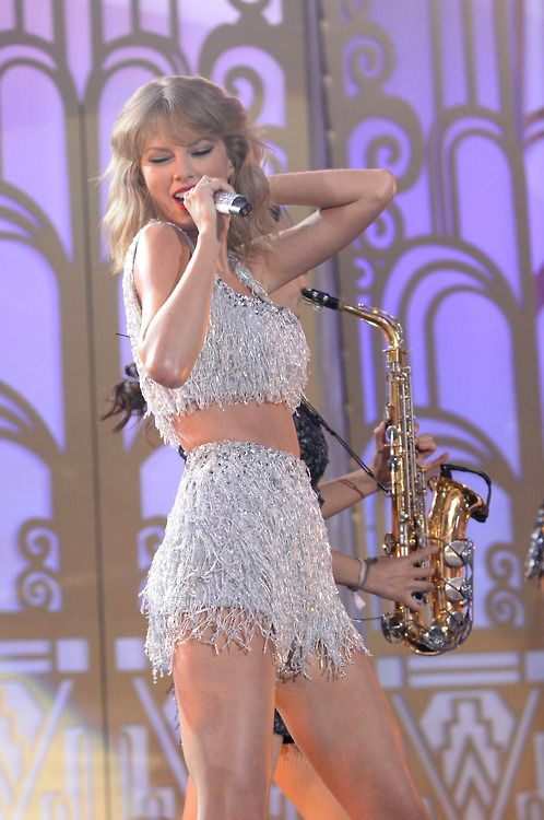 shake it off performance - her outfit is like the 1989 version of the sparks fly dress and I love it