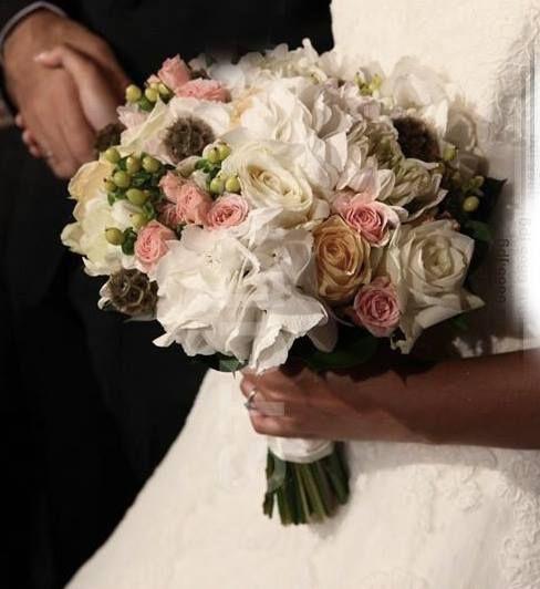 Sprayroses , hydrangea , roses , hypericum , scabiosa wedding bouquet