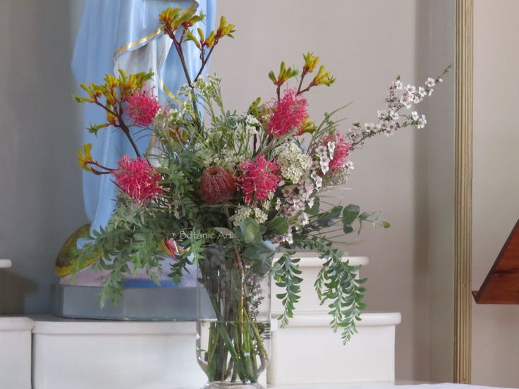 Church flowers, ceremony flowers,  tall vase arrangement, Australian Native flowers, kangaroo paw, wax flowers, wattle foliage, coccinea, grevillea. Church flowers do not always have to be 'pretty garden' flowers, go wild and give native flowers a chance to shine.