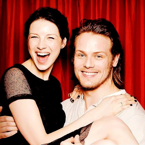 """samssassenach: """" I love this particular pic from the photoshoot. Just the way Sam has picked and gathered Cait in his lap/arms. They look extremely comfy with each other. And his hand, people. It just..."""