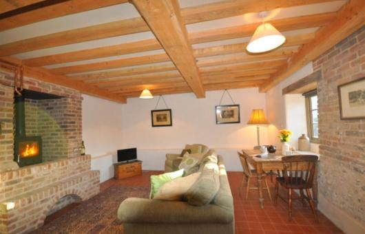 The main living area has underfloor heating and a woodburning stove - snug!