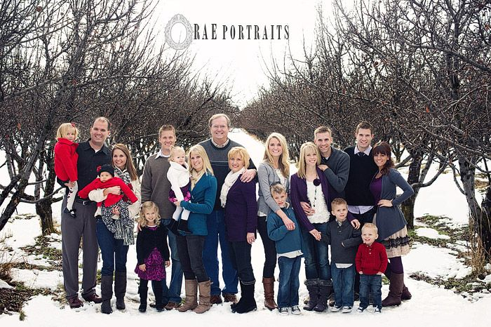 Blue, purple, and red colors for family picture. Love the trees and snow in the background.