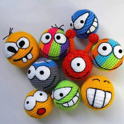 Crochet balls with embroidered faces. #amigurumi