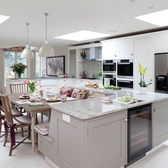 sleek grey kitchen traditional cabinetry can be given a modern touch with chrome handles stainless steel appliances and a polished granite worktop