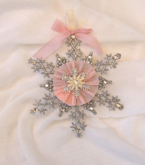 They sell those snowflake ornaments at the dollar store, just add a cute little decal and a bow and you have a cute little ornament!