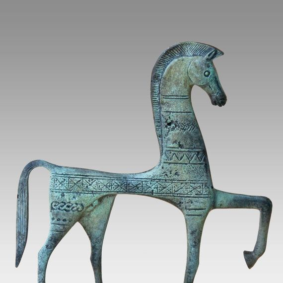 Large Greek bronze horse sculpture decorated in the geometric style Symbol of wealth and status Metal art sculpture, Museum quality Greek art The horse is inspired from archaeological exhibits in the Greek museums and sites Height: 9 inches / 23 cm approx. Width: 7.5 inches / 19 cm approx. **Listing is for ONE item only** As this item is hand made, measurements, surface texture and verdigris patina may vary slightly. This is more of my Greek horses collection http://www.etsy.com/shop/Gre...