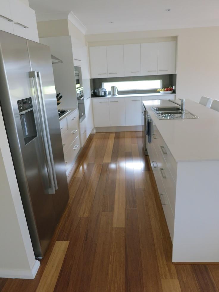 Floorboards save this white kitchen.