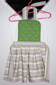 Sew a child's apron. Made with a pot holder and dish towel. This is a cute and fun project!