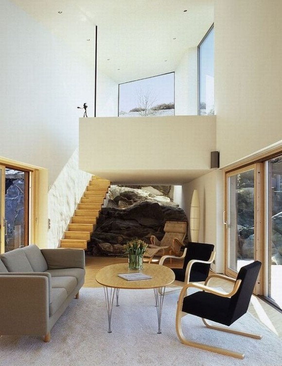 Living Room and Stairs to Upper Floor - Residence Built From Solid Cliff Rock