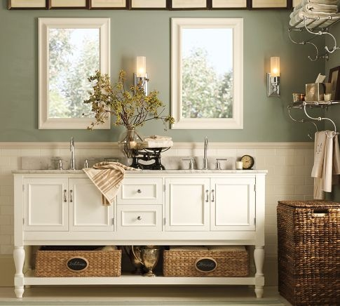 Combining vintage charm with modern-day functionality, our Newport Double Sink Console features a white Cararra marble countertop and matching white painted finish - Pottery Barn