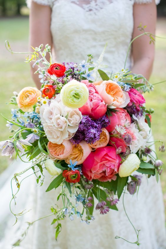 Bright + color happy bohemian wedding bouquet via Kate Haus / http://www.himisspuff.com/spring-summer-wedding-bouquets/4/