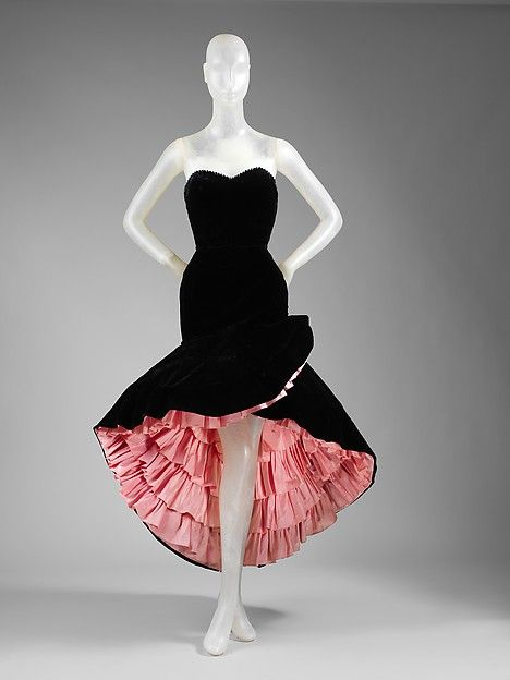 Evening dress 1951 A Spaniard, Balenciaga never failed to give passionate drama to the dress, imparting history and dance and ceremony in lace and in silhouette. A wide skirt with tiers of taffeta assures swing.