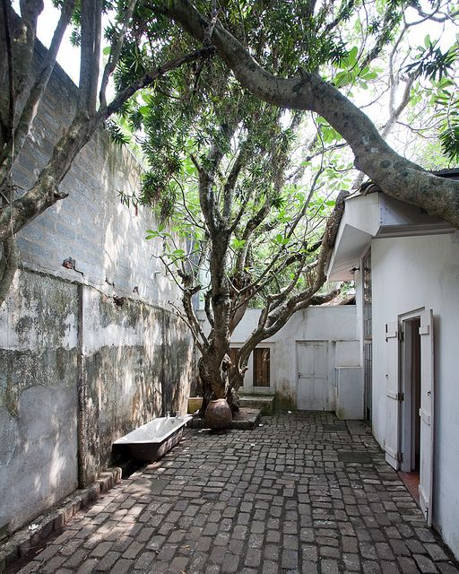 colombo, paved inner courtyard with trees and minimal benches