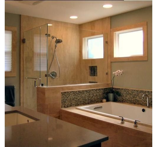 keep tub length but increase shower length out from wall to increase shower size but not lose tub or counter space