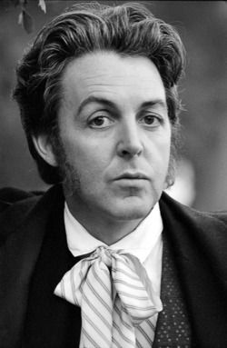 "Geez ... Paul, Paul McCartney, Beatles, Wings, hmmm... knighted by the queen of england... Sir Paul James McCartney II _ (I don't know if this hair & get-up isn't from early 80s 'Broadway"" flick that sorta died, or if it's from the MJackson video? To Sir With Love..."