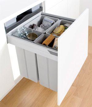 Rubbish bin in cupboard