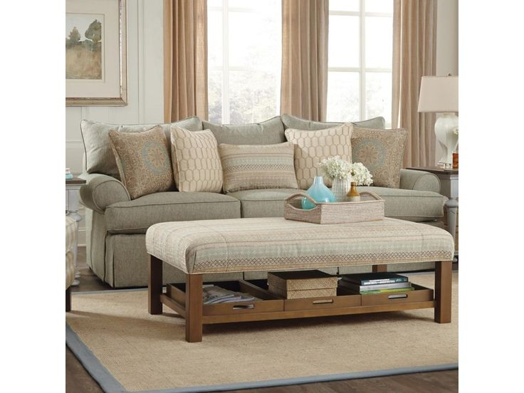 an array of cozy pillows add to the comfort of this sofa with rolled arms