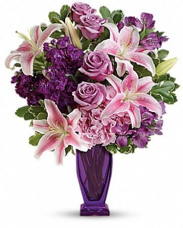 Oh so pretty in purples and pinks, this fabulous array of hydrangea and lilies is sure to make her blush! Artfully arranged and hand-delivered in our exclusive violet Couture vase, it's a luxurious treat for any occasion. This special bouquet features light pink hydrangea, lavender roses, pink stargazer lilies, purple alstroemeria, purple stock, and variegated pittosporum. Delivered in our violet Couture vase.$69.95