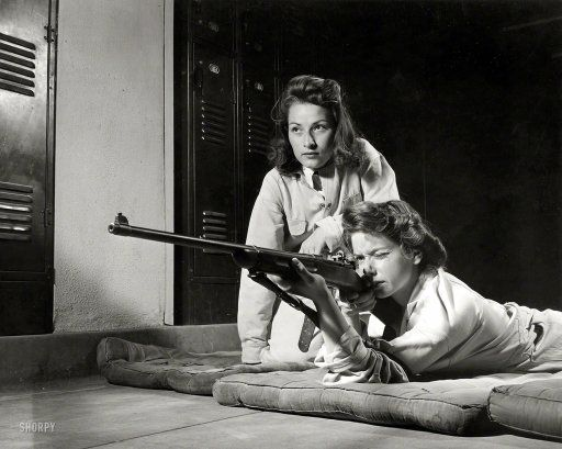 """1942: """"Training in marksmanship helps girls at Roosevelt High School in Los Angeles develop into responsible women."""""""