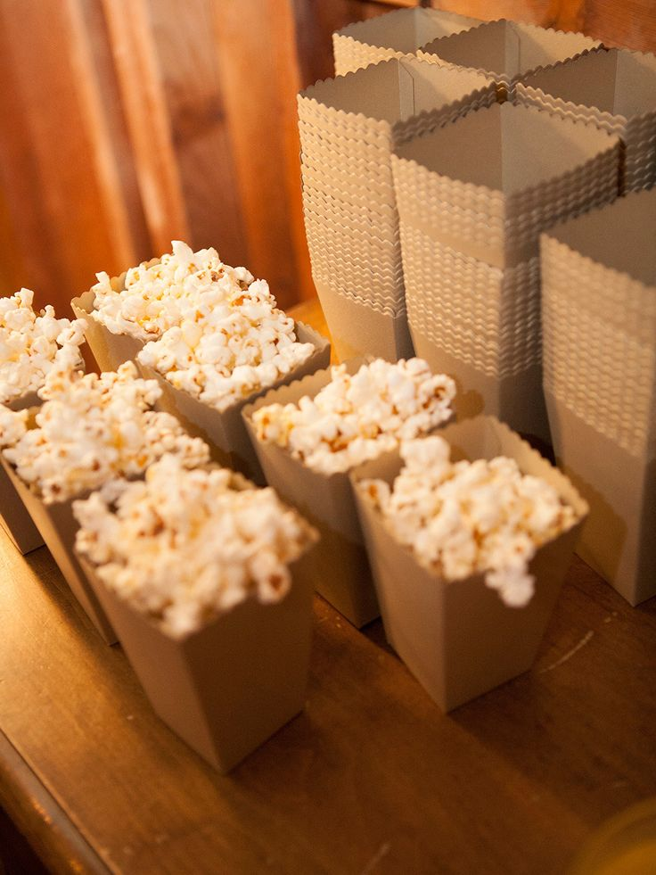 Popcorn Bar - with all sorts of toppings. On SMP: See the wedding on SMP: http://www.StyleMePretty.com/2014/02/19/classic-santa-barbara-wedding-at-apple-creek-ranch/ Photography: Lane Dittoe