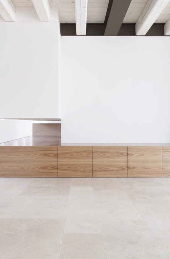 Wood and white interior by EXiT architetti associati.