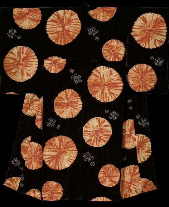 Shibori Undergarment. Meiji period (1868-1911), Japan. The Kimono Gallery.  A very unusual silk shibori woman's juban featuring a unique design consisting of large graphic tie-dyed circles over a peacock-feather pattern rinzu (damask) base.