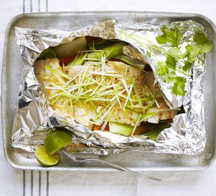 Steamed fish with ginger & spring onion. Take an Asian approach to low-fat cooking - steam fish with pak choi, mirin, garlic and soy and serve topped with coriander.