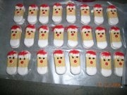 Santa cookies made with Vienna Fingers and melted white chocolate
