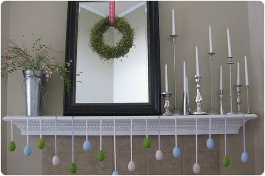 Easter Mantle - love the eggs hanging with ribbon, silver candle sticks, and mirror with wreath