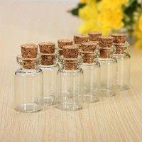 Features: Material:Glass/Cork Detailed Size:23mm(Length) 13mm(Width) The cute little glass bottles a