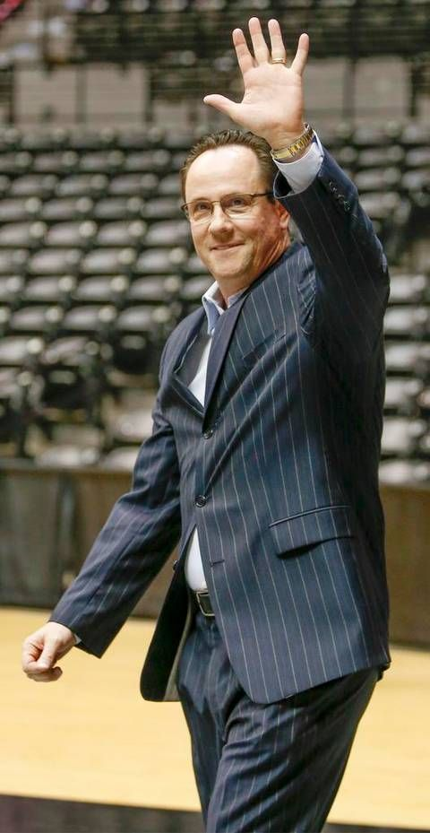 Wichita State coach Greg Marshall acknowledges the crowd as he enters Koch Arena at the WSU basketball awards celebration at Koch Arena Thursday. (April 16, 2015)