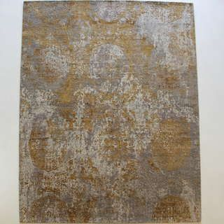 Create an opulent tone for your space with our luxurious Pyrenees Gold rug. Gold has been used in interiors as far back as ancient Egypt. Hand knotted from wool and bamboo silk, the Pyrenees rug features a gorgeous abstract design against a soft grey background.