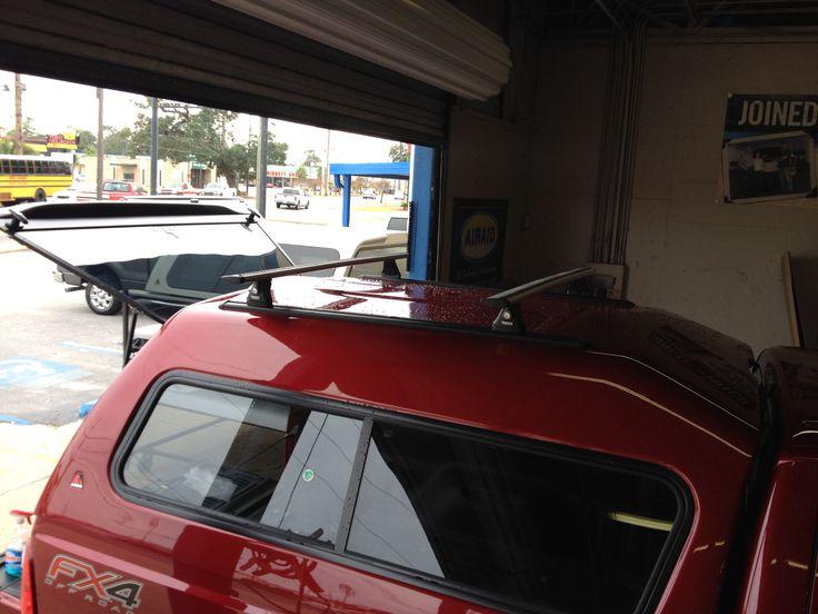 Leer 180 with Thule Aero blade roof rack. Ford f250